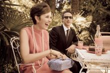 10896349 - retro sixties style fashion couple having breakfast outdoor